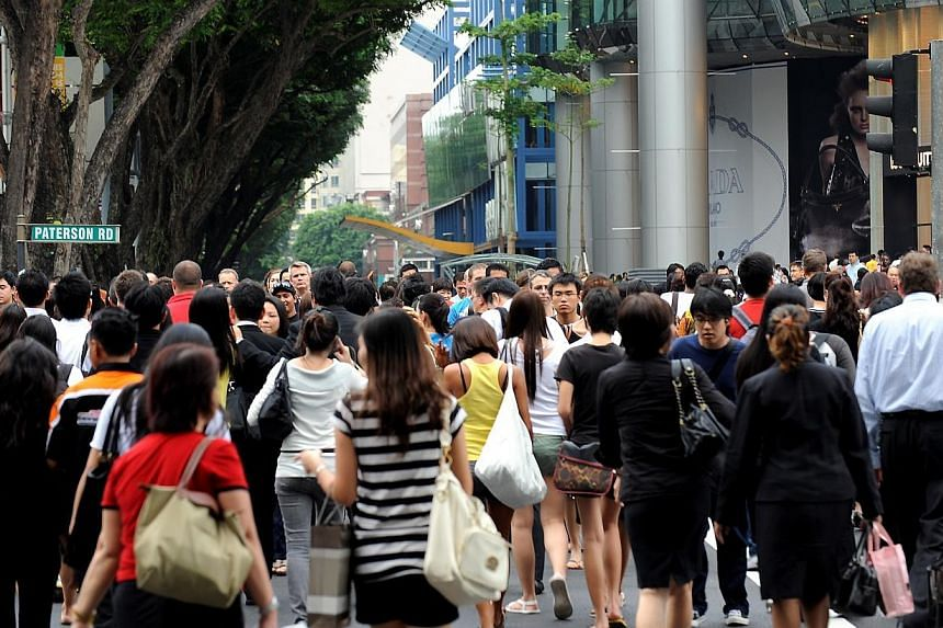 Pedestrians crossing Paterson Road, at the junction of Orchard Road, between Wheelock Place and ION Orchard.There is a growing discomfort across nationalities, even as comfort levels across race and religion appear to have largely remained the