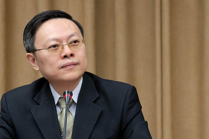 Wang Yu-chi, minister of Taiwan's Mainland Affairs Council, listens to a question during a press conference in Taipei, on Jan 28, 2014.Taiwan's minister in charge of China affairs said he will discuss the exchange of liaison offices, as well as