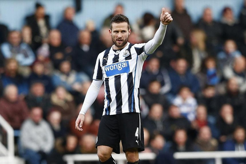 Yohan Cabaye of Newcastle United gives his bench the thumbs up after scoring against West Ham United during their English Premier League soccer match at Upton Park in London, on Tuesday, Jan 18, 2014. Newcastle United have agreed to sell France inter