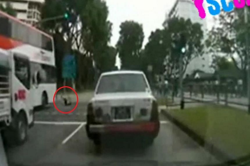 """Screengrab of theSBS Transit double-decker bus hitting the pedestrian (circle in red) as she was crossing a traffic light junction at Upper Serangoon Road on Jan 20, 2014.SBS Transit has said it will take """"strict disciplinary action"""" agai"""