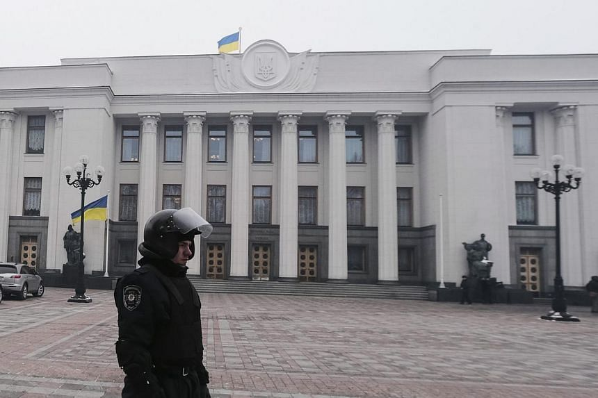 A riot policeman stands on duty outside the Parliament in Kiev, Ukraine, on Tuesday, Jan 28, 2014. Ukrainian President Viktor Yanukovych in a decree on Tuesday accepted the offer of resignation from Prime Minister Mykola Azarov and the entire ca