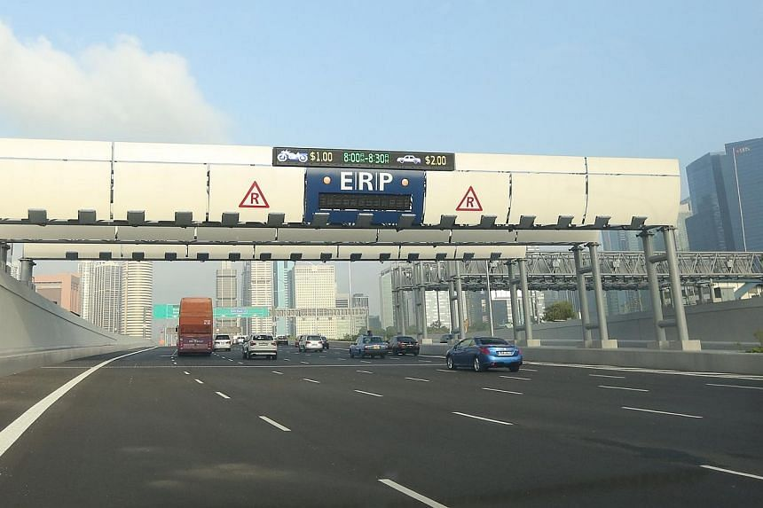 ERP on the Marina Coastal Expressway on Jan 2 , 2014.Electronic Road Pricing (ERP) rates will fall by as much as $2 across seven gantries and go up by $1 for four others from February to May, said the Land Transport Authority on Tuesday. -- FIL