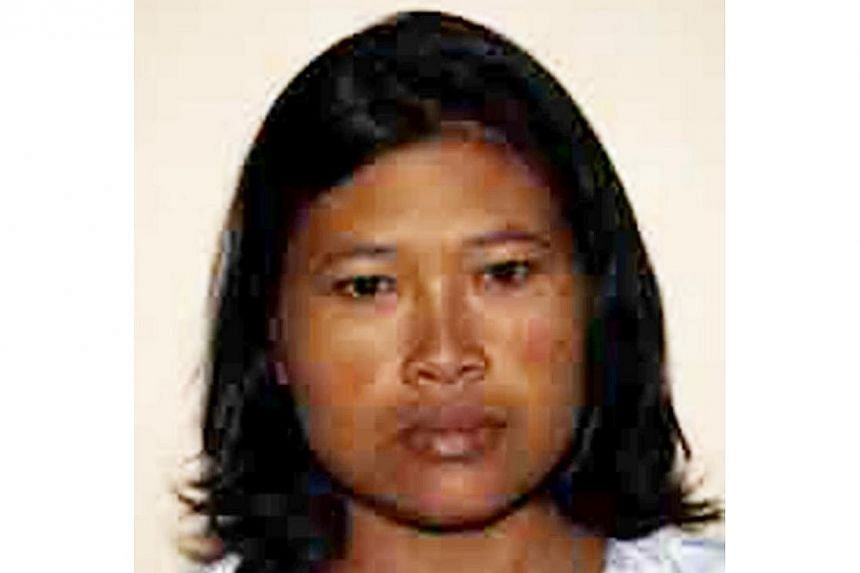 Musliyati, 37, an Indonesian maid who buried the body of her new-born in the backyard of her employer's house in Serangoon Gardens was jailed for three months on Tuesday. -- PHOTO: SINGAPORE POLICE FORCE