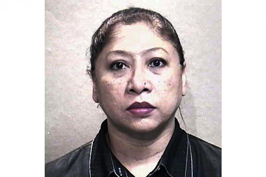 Noriah Bte Bakar,a Singaporean businesswoman, who helped two Nigerian men launder an unprecedented amount of $5 million, was sentenced on Tuesday to six years in jail. It is the longest jail term ever imposed for a money mule. --- PHOTO:S