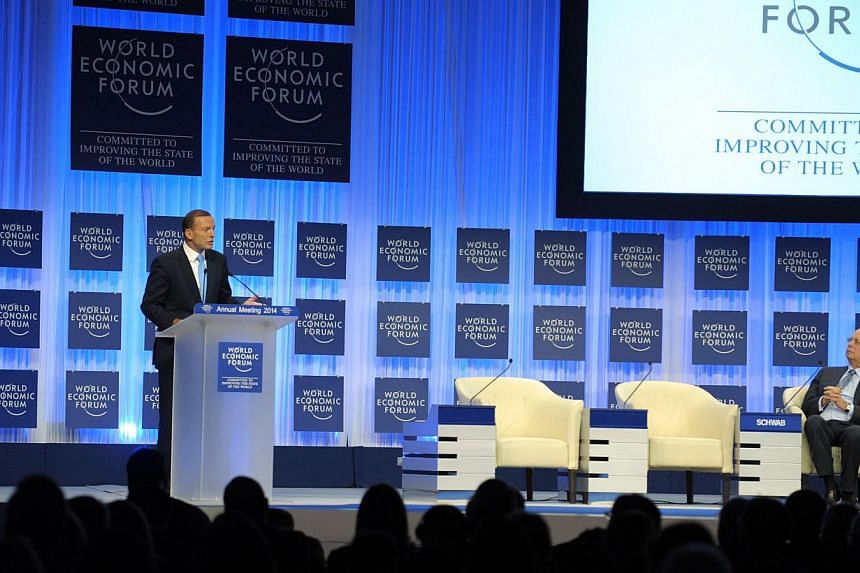 Australian Prime Minister Tony Abbott addresses the World Economic Forum in Davos on Jan 23, 2014. Prime Minister Tony Abbott on Tuesday compared accidental naval incursions into Indonesian waters during asylum-seeker operations to dropping a ca