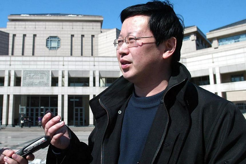 Economist Xia Yeliang was fired last October from the prestigious Peking University after a 13-year tenure for what he said were his political stances but the university attributed the dismissal to poor teaching.-- FILE PHOTO: AFP