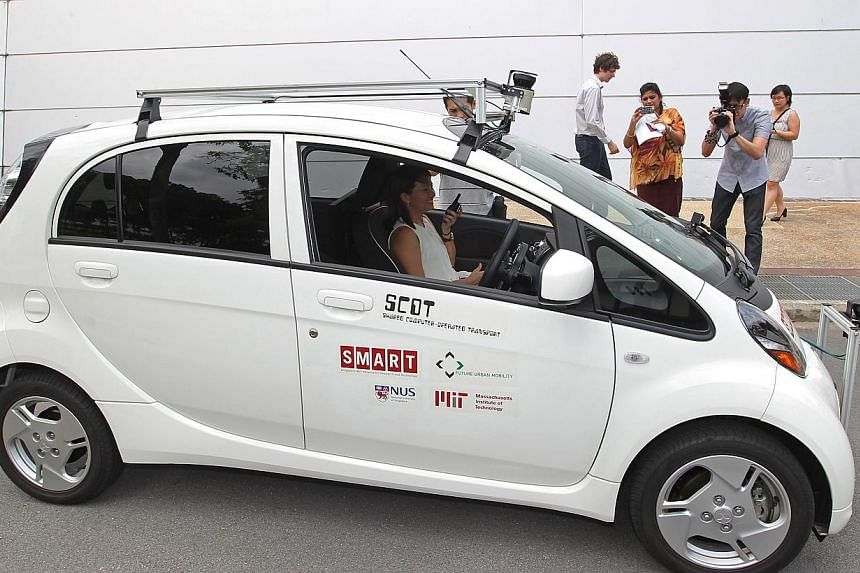 The Shared Computer Operated Transport - or Scot - car (above), launched yesterday by the Singapore-MIT Alliance for Research and Technology and National University of Singapore. The Singapore-made driverless vehicle makes use of laser sensors, which