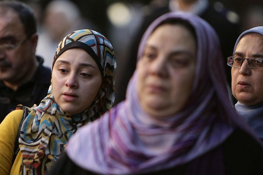 Relatives of General Mohamed Saeed, head of the technical office of the minister of interior, cry during his funeral in Cairo on Jan 28, 2014.Islamist militant gunmen on a motorcycle killed a top Interior Ministry official in Cairo on Tuesday i