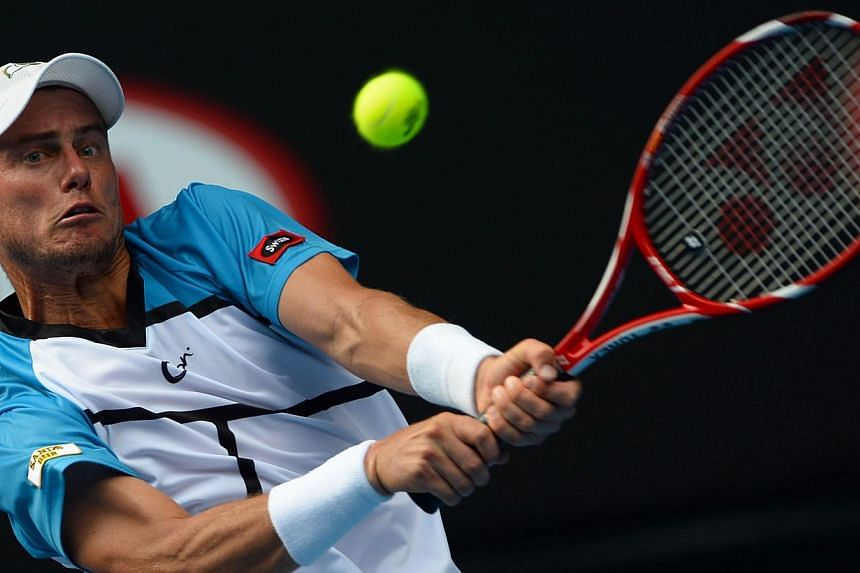 Australia's Lleyton Hewitt plays a shot during his men's singles match against Italy's Andreas Seppi on day two of the 2014 Australian Open tennis tournament in Melbourne on Jan 14, 2014. Veteran former world number one Lleyton Hewitt is relishi