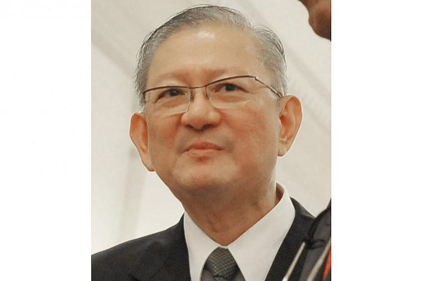 Lim Cheng Hoe, the former Ministry of Foreign Affairs (MFA) protocol chiefat the heart of a pineapple tarts scandal is expected to plead guilty to cheating, at a mention in three weeks.-- ST FILE PHOTO:ALPHONSUS CHERN