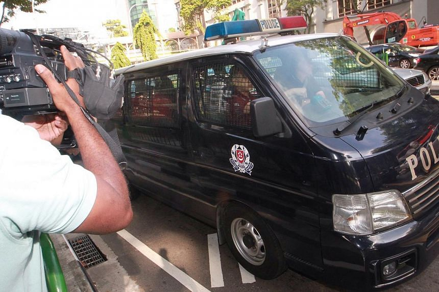 The rioters arrested for the fracas that happened in Little India arrive at the Subordinate Courts to be charged for vandalism and rioting with a deadly weapon, on Dec 10, 2013. A second pre-trial conference has been set for the cases against 24 Indi