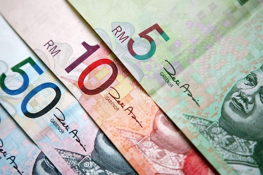 The Malaysian ringgit slumped to an all-time low against the Singapore dollar earlier this week, but recovered slightly on Wednesday amid a relief rally among emerging market currencies. -- PHOTO:BLOOMBERG