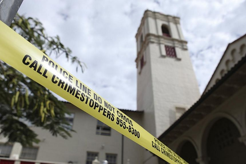 Police tape cordons off an area at Roosevelt High School after a shooting incident in Hawaii Jan 28, 2014. -- PHOTO: REUTERS