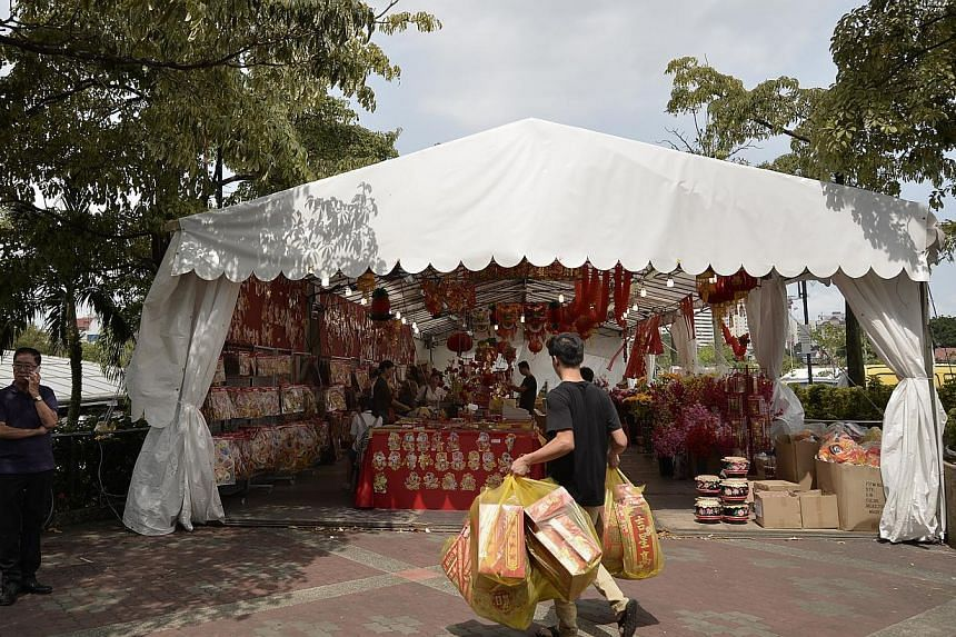 Shopkeepers in Hougang were fined for putting up a festive fair tentage outside the 1m boundary line.Aljunied-Hougang-Punggol East Town Council (AHPETC) is taking the People's Association (PA) to task over a Chinese New Year fair set up beside