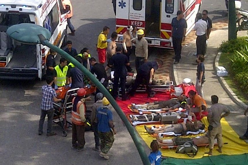 A scaffolding at a construction site on Sentosa collapsed on Wednesday afternoon, killing one worker and injuring 10 others.-- PHOTO: COURTESY OF POSMAN SIANTURI