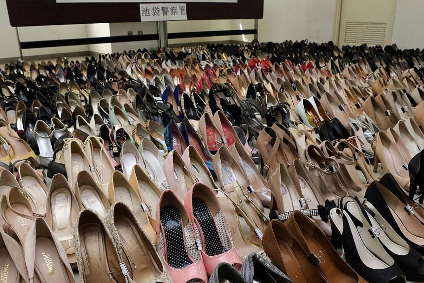 Japanese police display a total of 450 pairs of high-heeled shoes at a police office in Tokyo on Jan 29, 2014.A man arrested for stealing high-heel shoes from a Tokyo hostess club was found to have a total of 450 purloined pairs when his room w