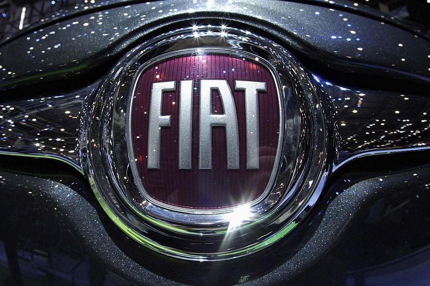 The Fiat logo is seen in a car displayed on the Fiat booth during the first media day of the Geneva Auto Show at the Palexpo in Geneva in this Mar 6, 2012 file photograph. Italian car giant Fiat on Wednesday, Jan 29, 2014, announced it was chang