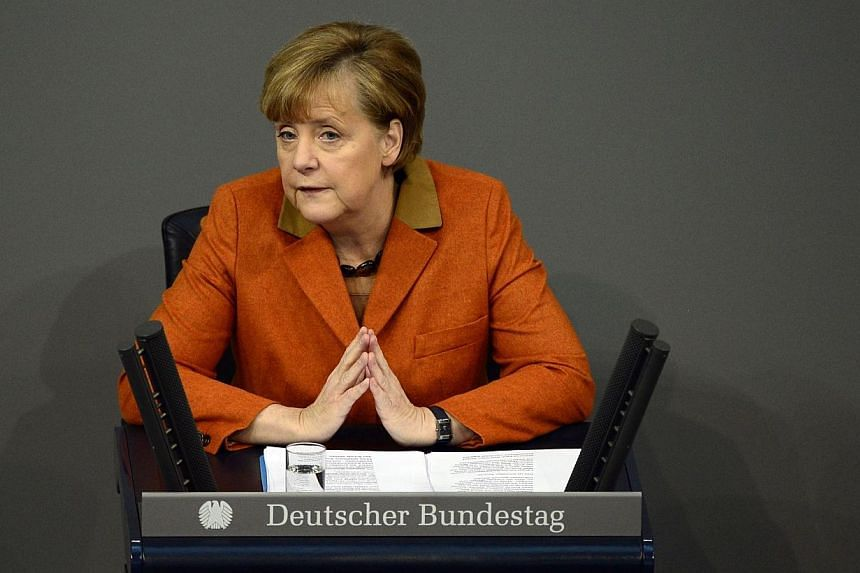 German Chancellor Angela Merkel speaks during a session at the Bundestag (lower house of parliament) on Jan 29, 2014 in Berlin.Chancellor Merkel on Wednesday underlined her support for Ukraine's pro-European protesters, saying their demands mus
