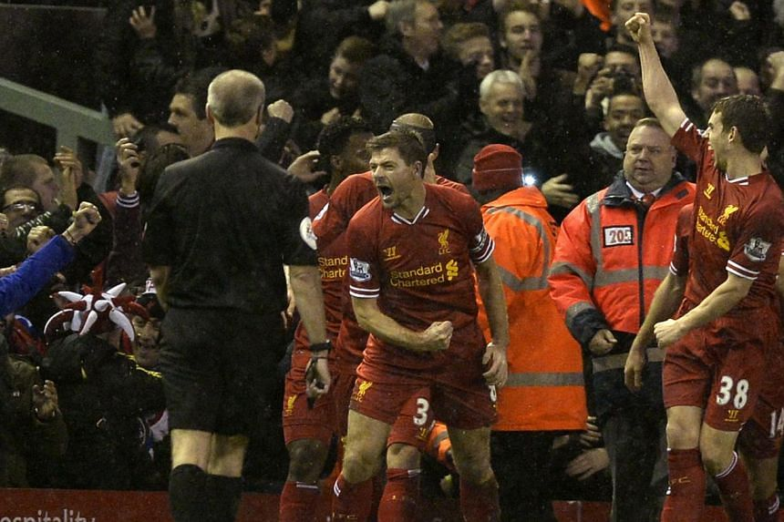 Captain Steven Gerrard (centre) opened the scoring for Liverpool in the derby match against Everton on Jan 28, 2014 to help his team gain the Merseyside bragging rights with a 4-0 victory over Everton in the Premier League on Tuesday, Jan 28, 2014, t