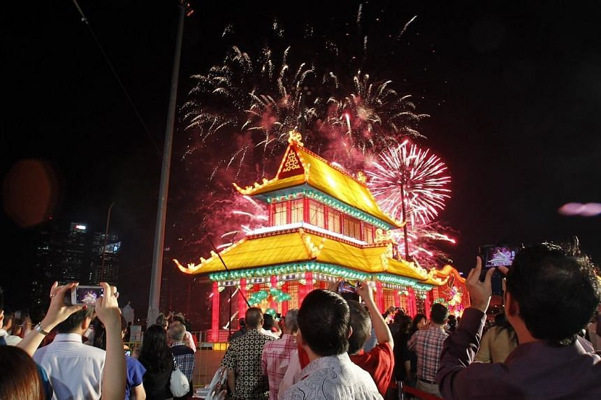 The annual River Hongbao carnival kicked off on Wednesday evening at the Floating Platform @ Marina Bay.-- ST PHOTO: KEVIN LIM