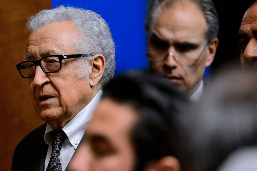 UN-Arab League envoy for Syria Lakhdar Brahimi (left) arrives for a press briefing at the United Nations on Jan 28, 2014 ,in Geneva.Neither of the warring sides in the Syria peace talks under way in Geneva was prepared to give up on Tuesday des