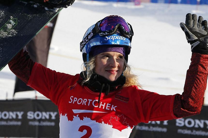 Dominique Maltais of Canada celebrates her second place finish during the women's finals at the FIS Snowboard Cross World Cup in Lake Louise, Alberta, Canada,on Dec 21, 2013.-- FILE PHOTO: AFP