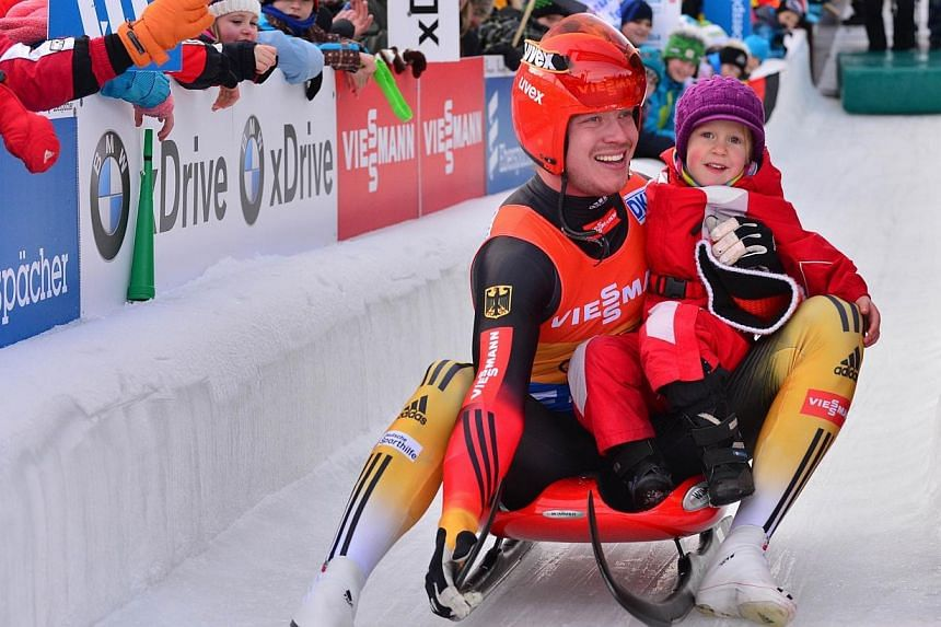 Germany's Felix Loch holds his niece Magdalena after winning the men's singles competition of the Luge World Cup in Oberhof, Germany, on Jan 12, 2014. -- FILE PHOTO: AFP