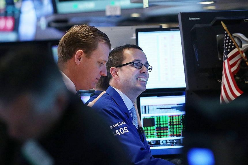 File picture of traders at New York Stock Exchange floor. -- PHOTO: AFP