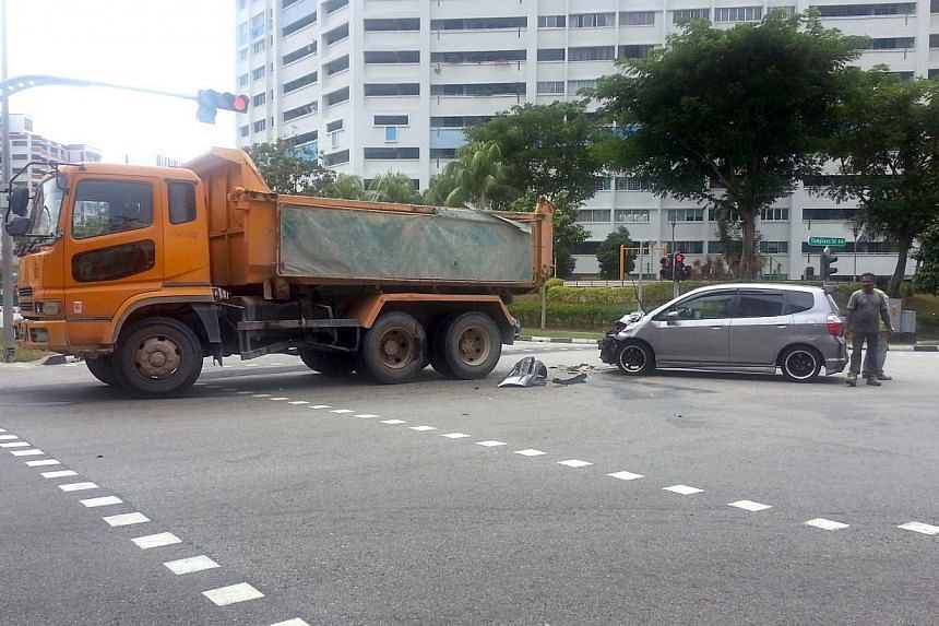 The scene of an accident on Monday involving a tipper truck and a car at the junction of Tampines Street 45 and Tampines Avenue 9.
