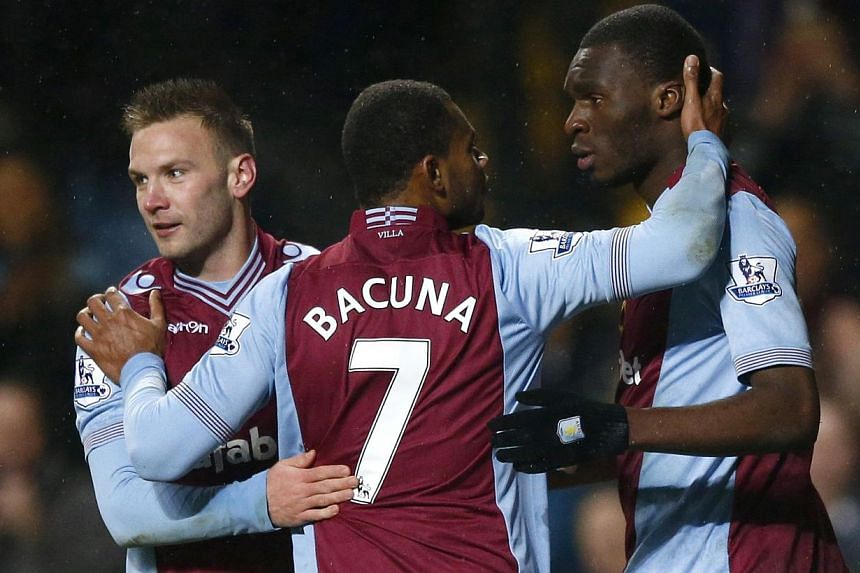 Aston Villa's Chrsitian Benteke (right) celebrates with team mates Leandro Bacuna (centre) and Andres Weimann after scoring a penalty against West Bromwich Albion during their English Premier League football match at Villa Park in Birmingham, central