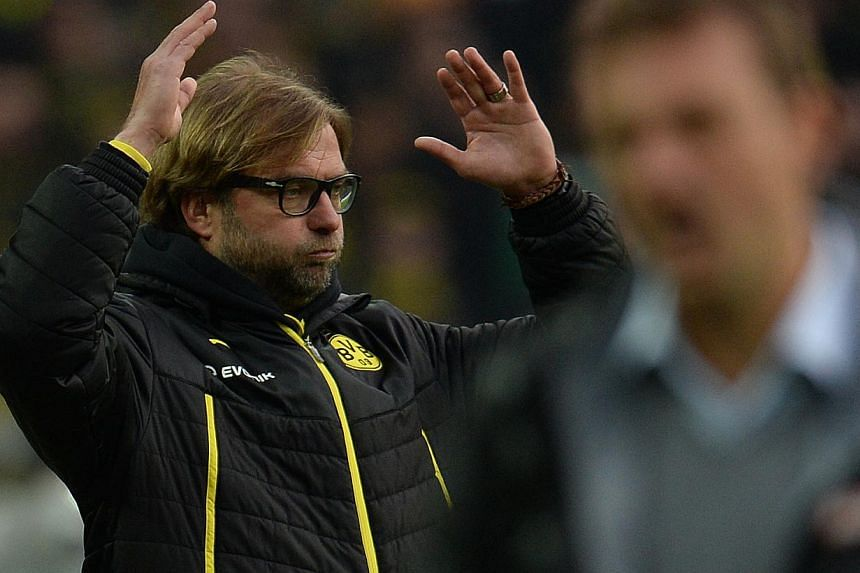 Dortmund's head coach Juergen Klopp reacts during the German first division Bundesliga football match Borussia Dortmund vs FC Augsburg in the German city of Dortmund on Jan 25, 2014. Coach Jurgen Klopp refused to confirm reports on Wednesday that Bor