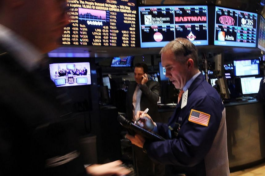 Traders work on the floor of the New York Stock Exchange after a Federal Reserve announcement on Jan 29, 2014 in New York City. United States (US) stocks dropped more than 1 per cent on Wednesday, hitting session lows after the Federal Reserve stuck