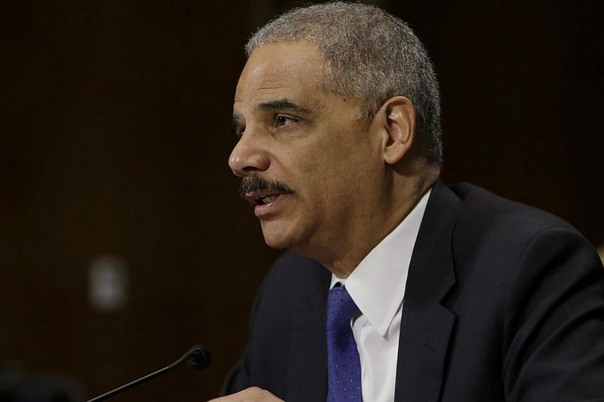 United States Attorney General Eric Holder testifies before the Senate Judiciary Committee hearing on oversight of the Justice Department and the reform of government surveillance programs, in Washington on Jan 29, 2014. Authorities are committed to