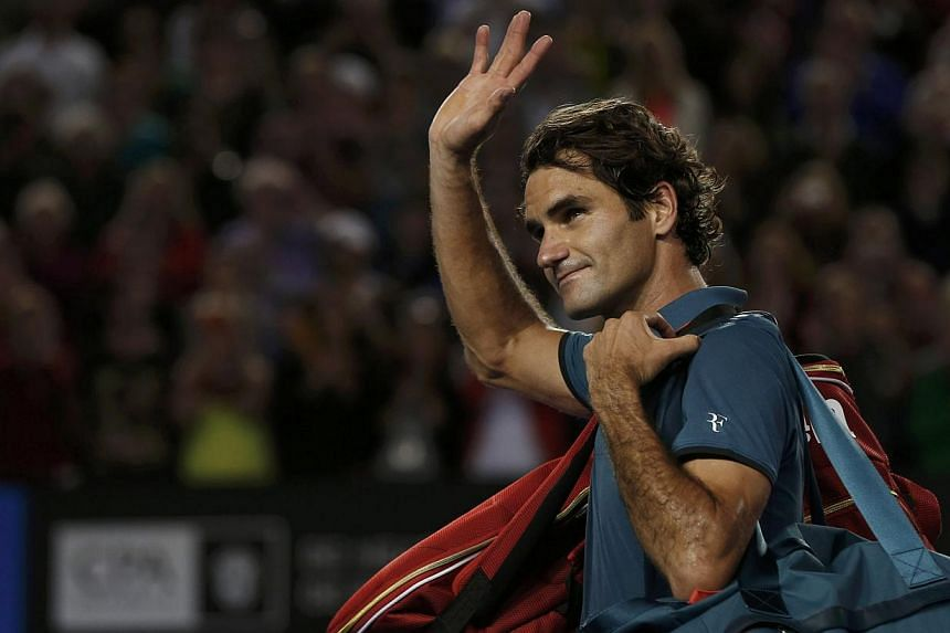 Roger Federer of Switzerland waves to the crowd as he leaves after being defeated by Rafael Nadal of Spain in their men's singles semi-final match at the Australian Open 2014 tennis tournament in Melbourne on Jan 24, 2014. Federer was on Wednesday co