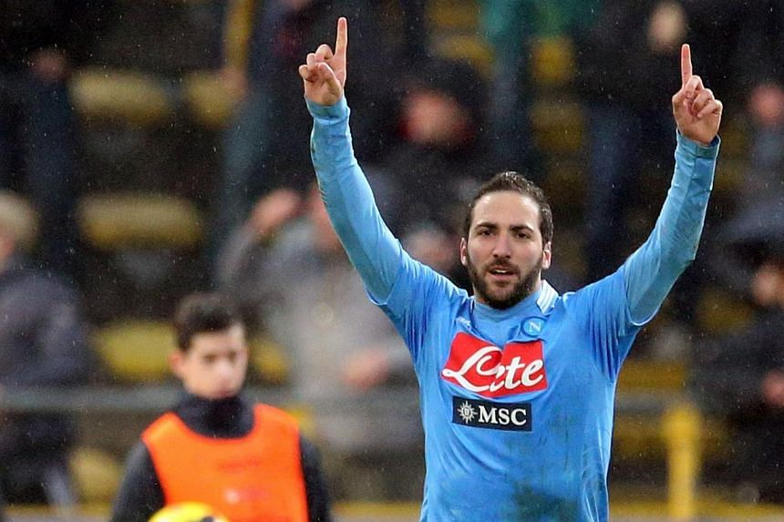 Napoli's forward Gonzalo Higuain celebrates after scoring a goal during an Italian Serie A football match between Bologna and Napoli at the Renato Dall'Ara stadium in Bologna on Jan 19, 2014. Napoli striker Gonzalo Higuain scored eight minutes from t