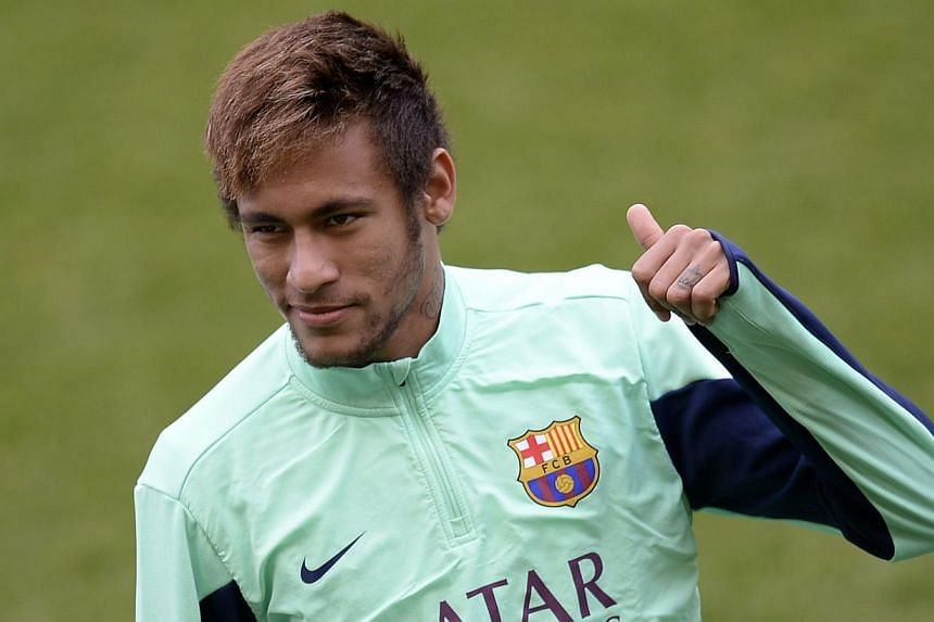 Barcelona's Brazilian forward Neymar da Silva Santos Junior gestures during an open training session at the Mini Stadium in Barcelona on Jan 3, 2014. Brazil's state prosecution service said on Wednesday it has called on tax authorities to probe the c