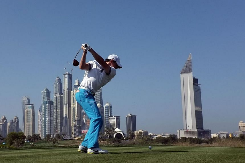Rory McIlroy of Northern Ireland drives from the 8th tee during the first round of the 2014 Omega Dubai Desert Classic in Dubai on Jan 30, 2014. McIlroy confirmed he is back on top form with a stunning 63 as the first round of the $2.5 million Dubai