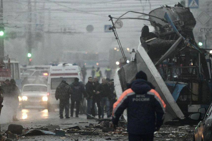 Members of the emergency services work at the site of a bomb blast on a trolleybus in Volgograd on Dec 30, 2013. Russia has identified two suicide bombers responsible for attacks that killed 34 people in the city of Volgograd last month and arrested