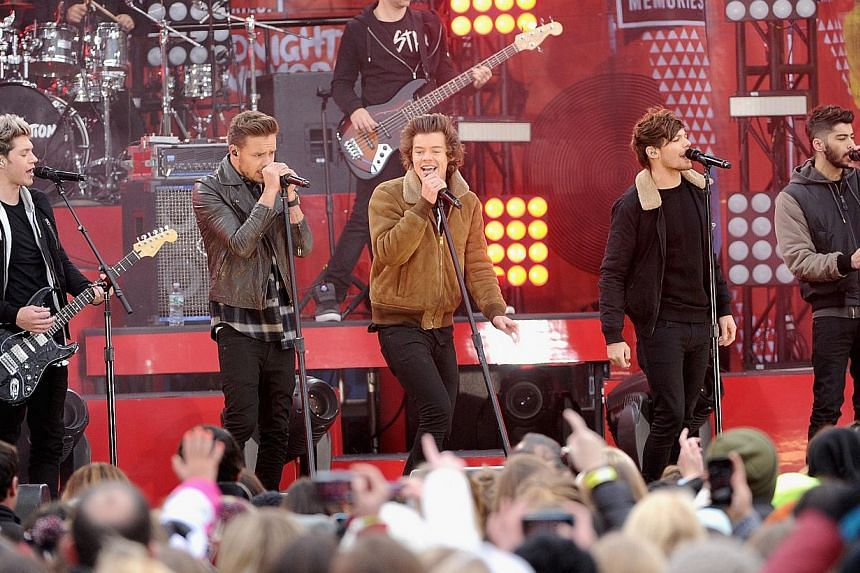 Niall Horan,Liam Payne, Harry Styles, Louis Tomlinson and Zayn Malik of One Direction perform at Rumsey Playfield in New York City on Nov 26, 2013. One Direction was named the most popular recording artist of 2013 on Wednesday, in a record industry a