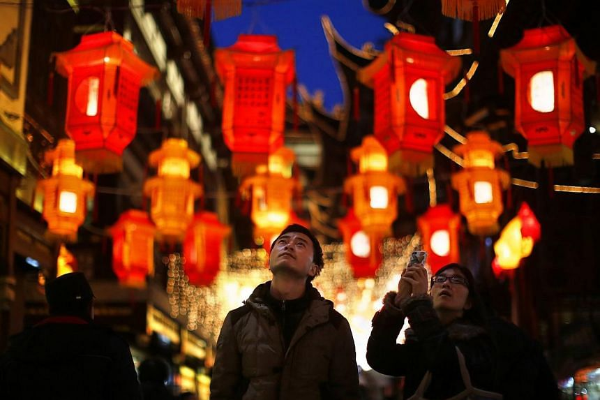 A couple look at Chinese New Year lanterns decorating Yuyuan Garden in downtown Shanghai, on Jan 28, 2014. -- FILE PHOTO: REUTERS