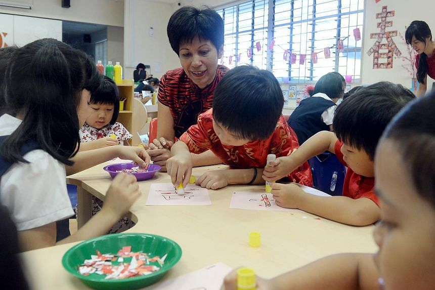 Ms Indranee Rajah (centre) at the MOE Kindergarten Punggol View and Punggol View Primary School Inaugural Joint Lunar New Year celebrations. The next five Ministry of Education (MOE) kindergartens, set to open in 2015, will be located in estates