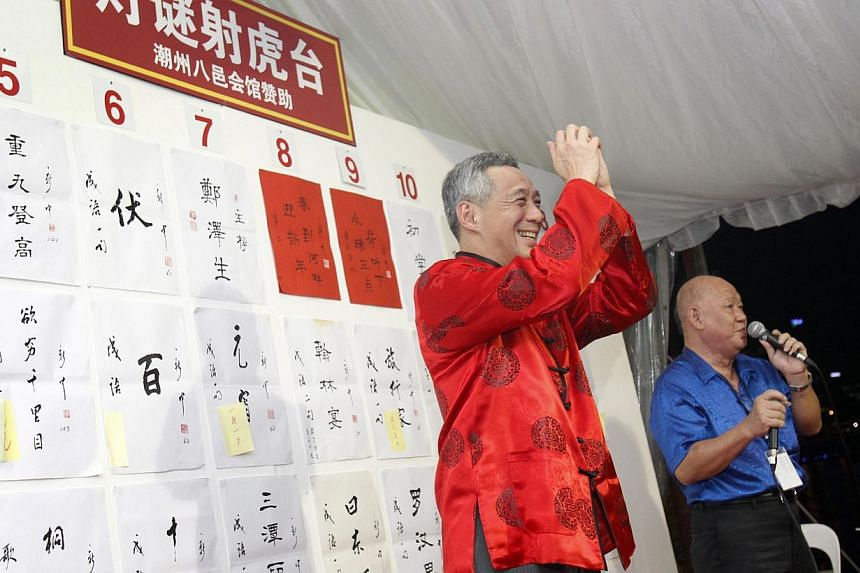 Prime Minister Lee Hsien Loong acknowledges the crowd after guessing a lantern riddle correctly at the River Hongbao opening ceremony on Jan 29, 2014. -- ST PHOTO: KEVIN LIM