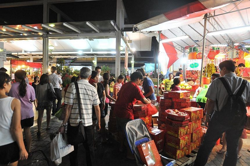Aljunied-Hougang-Punggol East Town Council (AHPETC) is set to appear in court on Feb 18, for operating a Chinese New Year fair from Jan 9 to 30, without a licence. -- ST PHOTO:LIM YAOHUI