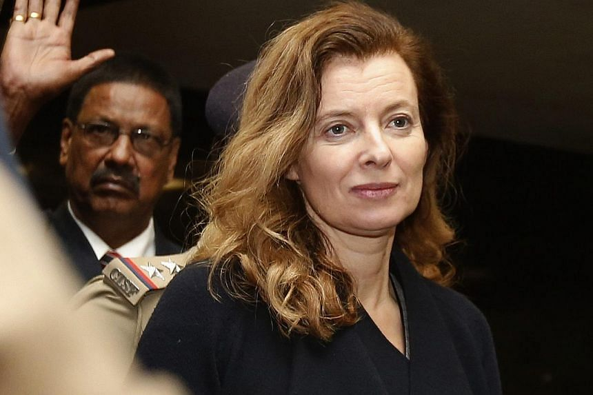 Valerie Trierweiler, former French first lady, walks to leave for her departure at the airport in Mumbai on Jan 29, 2014. France's former first lady Valerie Trierweiler has revealed she may write a book about her split with the President and said she