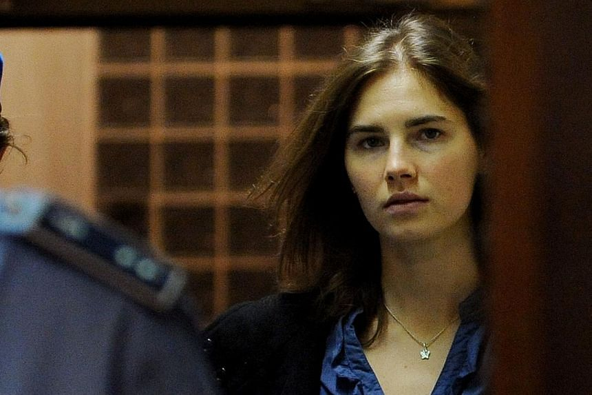 File picture of Amanda Knox, a US national accused of the 2007 murder of her housemate Meredith Kercher as she arrives at the court during the resumption of her appeal trial in Perugia. --PHOTO: AFP