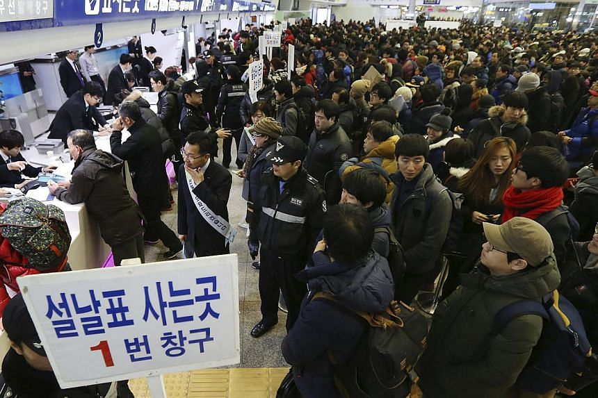 People waiting to buy tickets at a railway station in Seoul. There is tension between young and old as older South Koreans are financially unprepared for retirement, while the young cannot find jobs and take care of their parents. This conflict plays