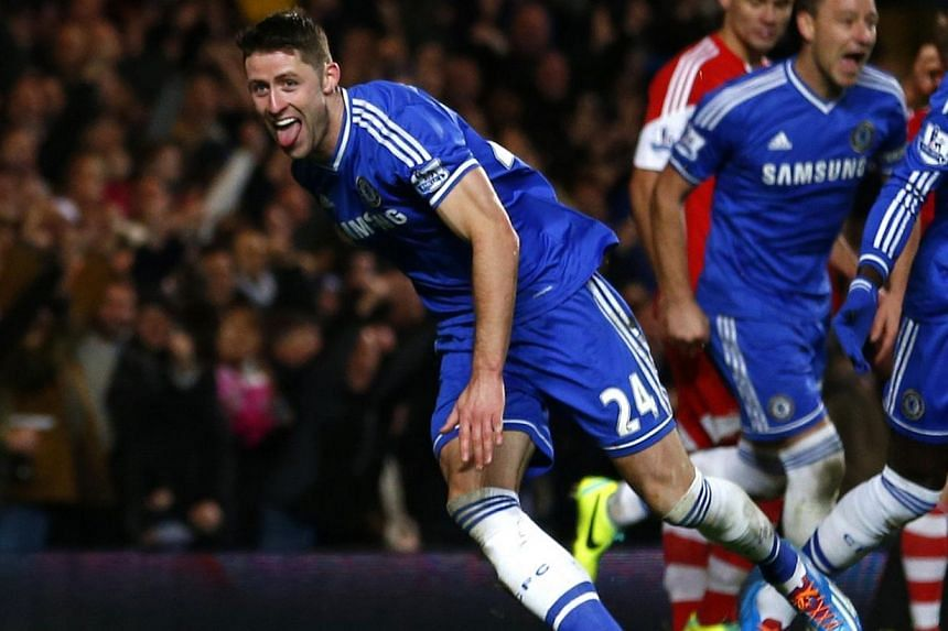 Chelsea's Gary Cahill celebrates after scoring a goal against Southampton during their English Premier League soccer match at Stamford Bridge in London on Dec 1, 2013. Cahill admits his side's crunch clash with Manchester City on Monday will be the u
