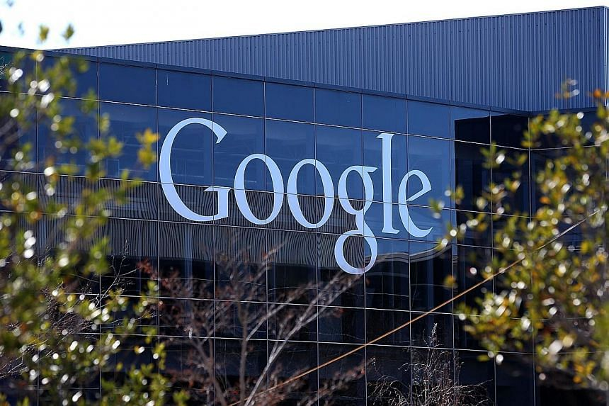 Google Inc's quarterly revenue beat Wall Street's target despite an ongoing decline in prices for its online ads and deepening losses at Motorola, the handset-making division to be sold to China's Lenovo. -- FILE PHOTO: AFP