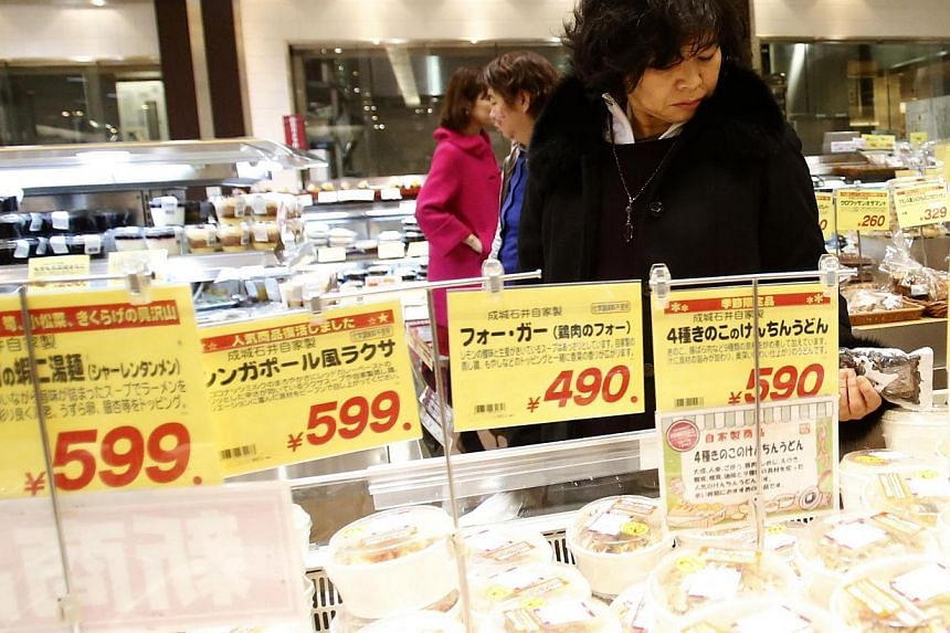 A customer looks at food products at a supermarket in Tokyo on Jan 30, 2014. Japan's core consumer prices rose 1.3 per cent in December from a year earlier, the fastest pace in more than five years, adding to evidence the economy is making steady pro