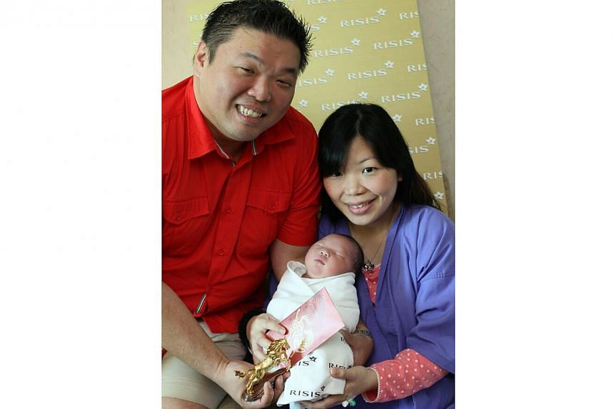 Mr Dennis Tee Jyh Eng, Ms Lee Bab Ing and their son Ashden Tee.. -- PHOTO: SHIN MIN